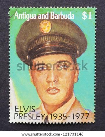 ANTIGUA & BARBUDA - CIRCA 1992: a postage stamp printed in Antigua and Barbuda showing an image of Elvis Presley, circa 1992. - stock photo
