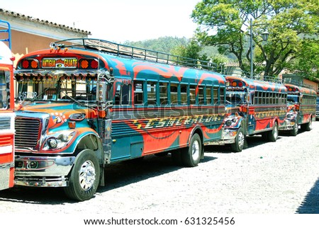 Antigua, Guatemala - April 2, 2017: Typical public transport in Guatemala called chicken buses because of colorful. Modern style boho chic.