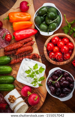 Antipasto and catering platter with raw vegetables and yogurt dip - stock photo