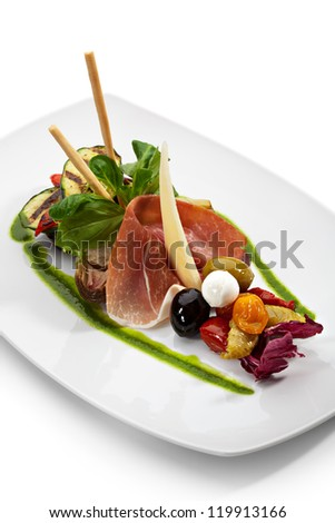 Antipasto - Italian meal. Includes Cured Meat, Artichoke, Parmesan Cheese, Olives and Zucchini