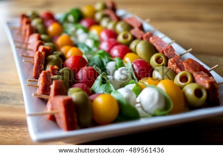 Antipasto skewers on a white plate