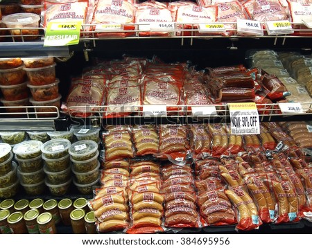 ANTIPOLO CITY, PHILIPPINES - FEBRUARY 10, 2016: A variety of choice meat cold cuts on a freezer shelf of a grocery store in Antipolo City, Philippines - stock photo