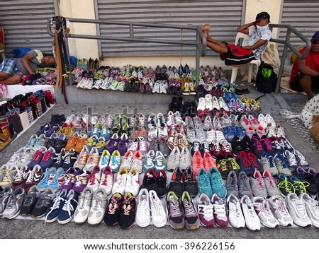 ANTIPOLO CITY, PHILIPPINES - MARCH 24, 2016: A variety of colorful shoes sold on a sidewalk in Antipolo City, Philippines - stock photo