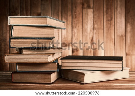 Antiquarian books on wooden table - stock photo