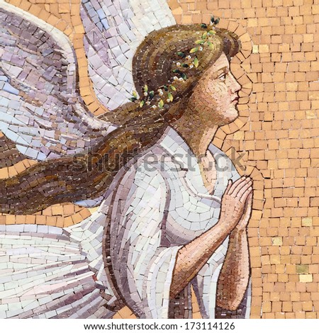 antique angelic decoration, mosaic on wall in Italy - stock photo