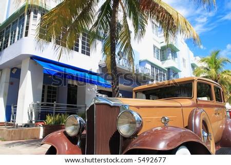 Antique automobile on ocean drive, Art Deco area of South Beach Florida - stock photo