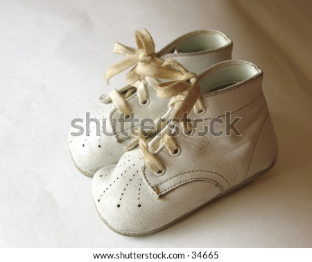 antique baby shoes - stock photo