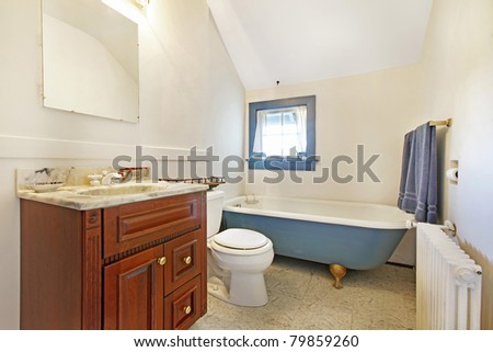 Antique bathroom with blue and cherry. Amazing home from 1856 has never been touched since then. All details remain original. Lakewood, Washington State, US.