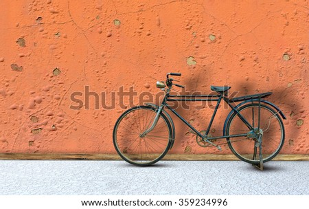 Antique bicycle on brick wall. - stock photo