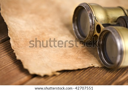 Antique binoculars on vintage background