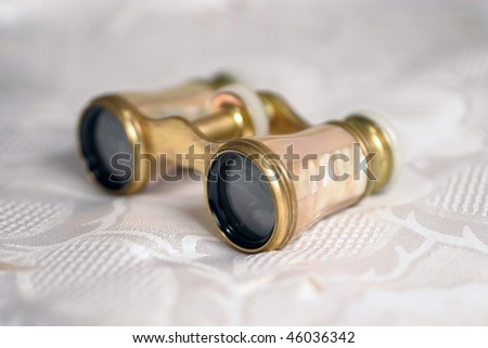 Antique binoculars to look at opera and plays. - stock photo