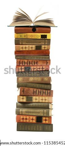 Antique book pile with open book in top isolated on white background - stock photo