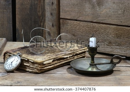 antique book with accessories on wooden background - stock photo