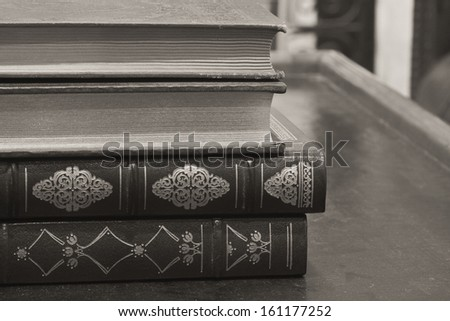 Antique Books - Antique Books with Gold Inlay Stacked on a Table - stock photo