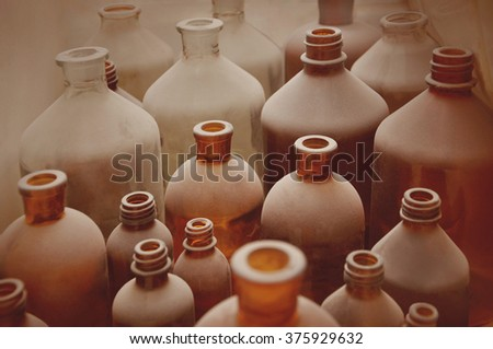 antique  bottles covered with dust in pharmaceutical laboratory - stock photo