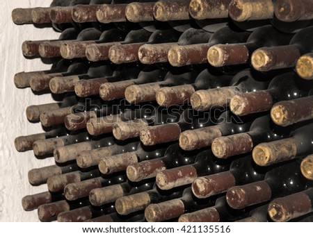 Antique bottles in the cellar - stock photo