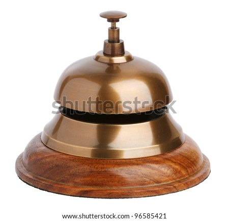 Antique brass bell with a button on white background - stock photo