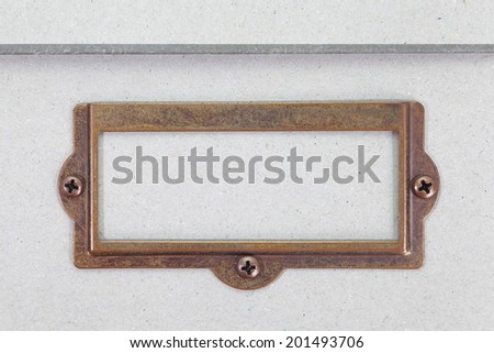Antique brass name plate on shoes box - stock photo