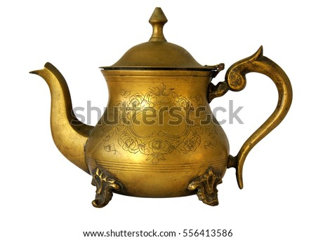 Antique brass teapot with a pattern isolated on white background