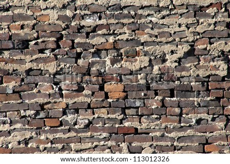 Antique brick and mortar wall closeup - stock photo