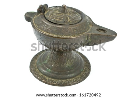 Antique bronze oil lamp isolated on white - stock photo