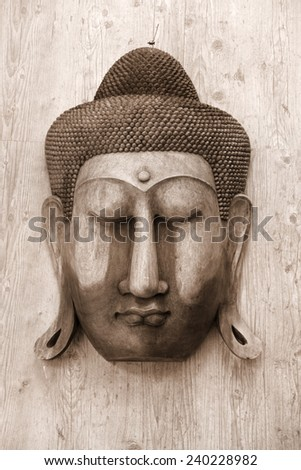 Antique Buddha carving on the wooden wall - stock photo