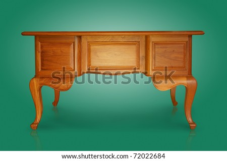 Antique carved wooden table isolated on magenta. - stock photo
