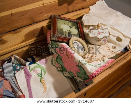 antique cedar chest with vintage linens, photographs and knicknacks - stock photo
