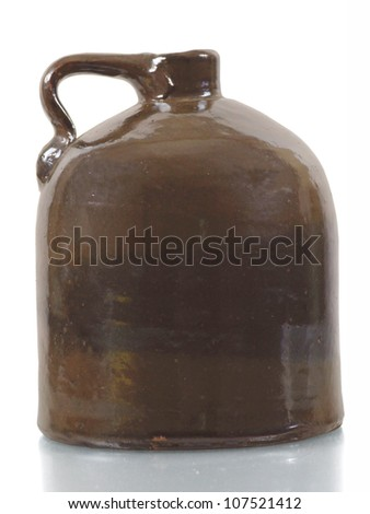 Antique ceramic jug on white background - stock photo