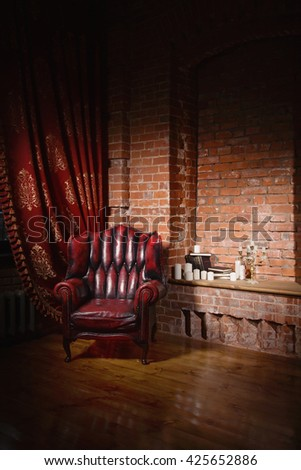 Antique chair against a grungy brick wall