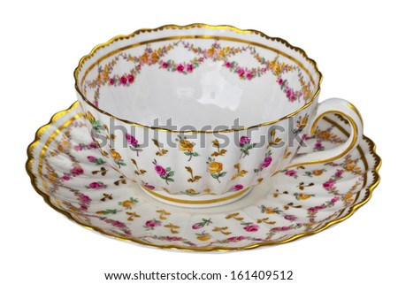 Antique china tea cup and saucer isolated on white. - stock photo