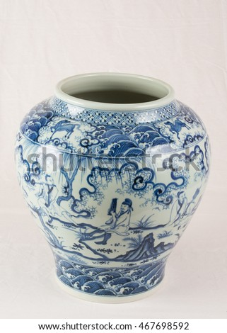 Antique Chinese underglaze blue and white wine jar, from the Ming Dynasty. White background.