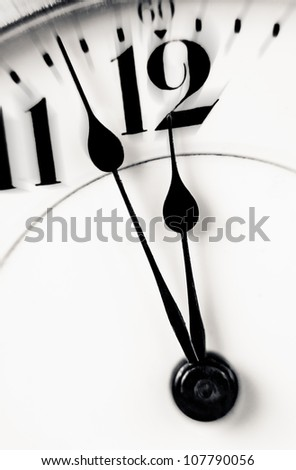 Antique clock closeup showing a few minutes to midnight. Concept of time,the past or deadline. - stock photo