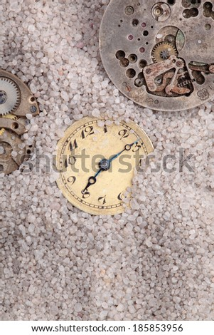 antique clocks buried in sand - stock photo
