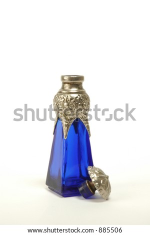 Antique cobalt blue bottle with silver collar and stopper - stock photo