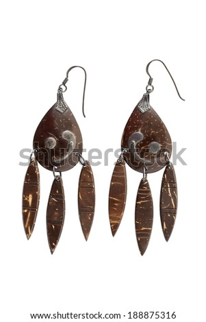 Antique coconut shell earring isolated on white background