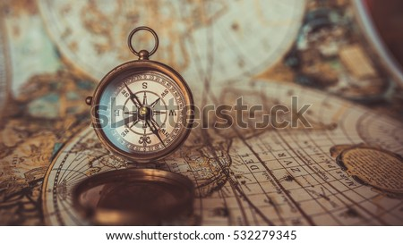 Antique compass old world map vintage imagen de archivo stock antique compass and old world map vintage style gumiabroncs Image collections