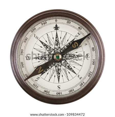 Antique compass in a brass case on  white background - stock photo
