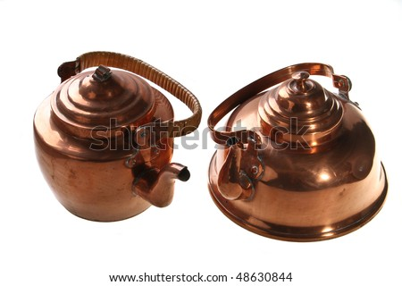 antique copper kettles. - stock photo
