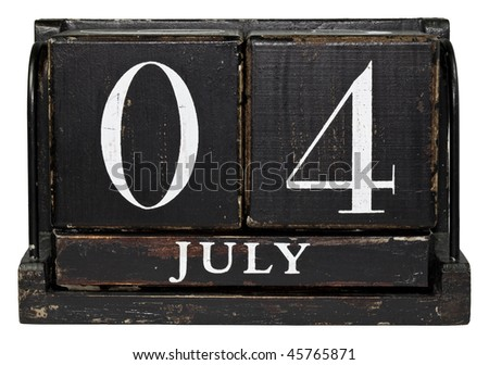 Antique Cube Calendar showing July 4 - Independance Day isolated on a white background - stock photo