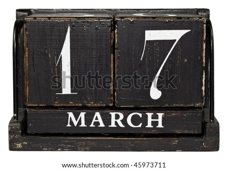 Antique Cube Calendar showing March 17 - Saint Patrick's Day isolated on a white background - stock photo