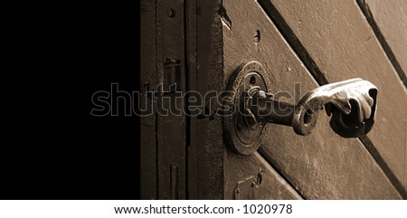 Antique door - close-up. Isolated on black