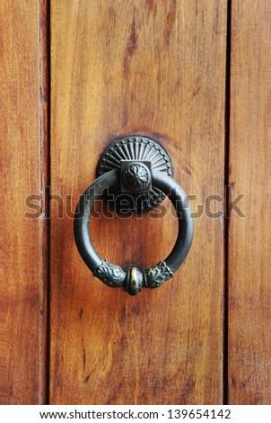 antique door knocker - stock photo