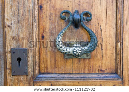 Antique doorknob with a keyhole - stock photo