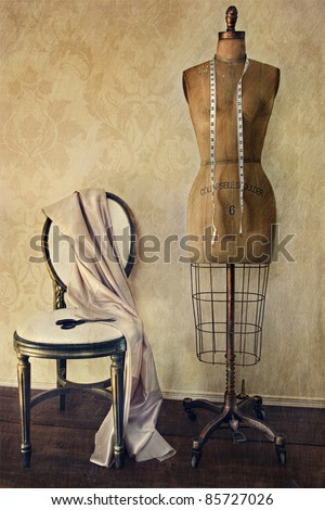 Antique dress form and chair with vintage look - stock photo