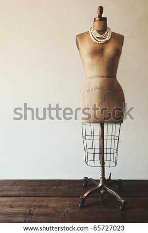 Antique dress form with vintage feel - stock photo