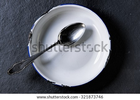 antique empty bowl with spoon