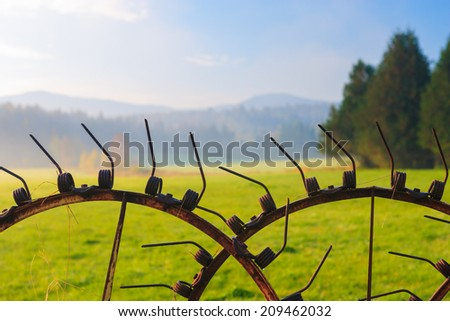 Antique farm implement in a farming landscape, Stowe Vermont, USA