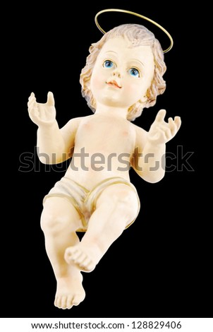antique figure of baby jesus isolated on black background - stock photo
