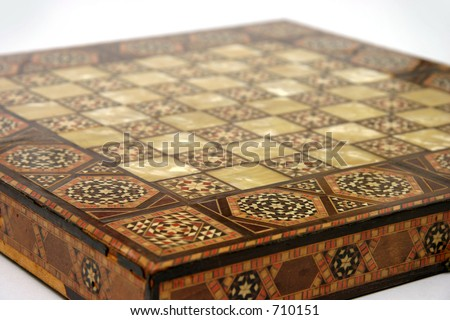 Antique foldable wooden chessboard with 'mother of pearl' squares set in.